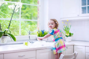 girl at water faucet, clean water, healthy water for kids and family